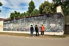 People fill this giant chalkboard in Prague's Kampa Park with things they want to do before they die