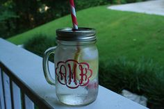 Scalloped outline, filled letters in, purple. Lime Green straw. Monogrammed Mason Jar To Go Cup with Handle