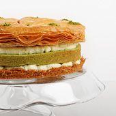 Arabic Cake, Delicate layers of sweet kelaj pastry, soft pistachio cake, crispy kunafa, and creme fraiche