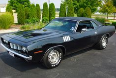 Building on my previous pin, I must, MUST, add this 1971 Blacked out Cuda.
