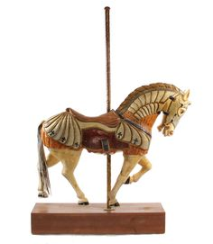 Sale 304 Lot 5 Replica of a Philadelphia Toboggan Company Horse in Armor, ca 1905, hand carved wood with original paint (some retouching), real horse hair tail (replaced). Later spiral brass pole. Identical to one on the Kit Carson County Carousel, originally made for Elitch Gardens in Denver, Colorado. SOLD $2,750 #carousel