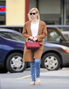 January Jones wearing a Leon Max coat, jeans, and a red bag // #Casual #Style