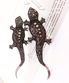 Salamander lover? These earrings are one-of-a-kind and so unique. Antique Sterling silver, and larger. A personal favorite from my Etsy shop https://www.etsy.com/listing/385428864/vintage-sterling-silver-salamander