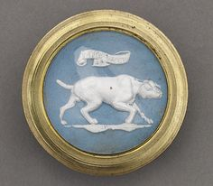 18th century hunt button under glass. Sulfide bas-relief mounted in a gold setting. TAKE HEED was a command used by 18th century hunters. The dog would freeze (as the button depicts) and allow the hunter to throw the net over the game before it flushed. Made in Birmingham and collected by James Luckcock.