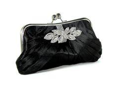 Black bridal bridesmaids clutch with rhinestone trim and crystal brooch.