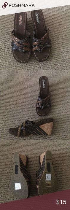 Brand new Skechers wedge size 7 Shades of dark and medium brown towns. Very comfortable. Size 7 US Skechers wedge. Has braiding detail and cork heal Skechers Shoes Wedges