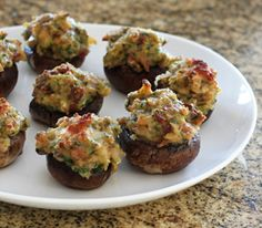 Stuffed Mushrooms Casino (bacon, canned clams, butter, parmesan cheese,  breadcrumbs, green or red bell pepper, onion, fresh parsley, egg, lemon juice)
