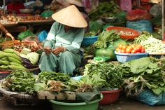 a lady selling vegetables at the market http://hoianfoodtour.com/holiday/da-nang-home-cooking-class/ #hoian #danang #cookingclass #foodies
