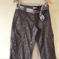 Super Cute Express Crop Cargo Pants Cool print and such cute details- satin belt, cargo pockets and shimmery strings to tie at the bottom.  I take offers through the offer button. 20% off bundles.  Express Pants Capris