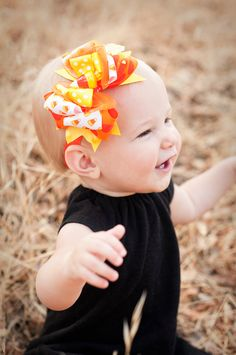SALE Candy Corn Halloween Combo Baby Headband, Halloween headband bow, Infant Headband, Baby Halloween Bow, Halloween Headband. $11.95, via Etsy.