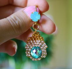 """The Azted Gold Earrings are made with sparkly gold toned Japanese seed beads, with turquoise glass beads in the center. Adorned with 2 milky blue Swarovski Gems. Put your hair in a bun and these earrings will impress everybody. They are approx. 5 cm long (2""""). No nickel.    For sale  http://www.etsy.com/shop/dutchbeadworks?show_panel=true"""