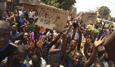 Central African Republic's interim leaders caved in to international pressure and resigned on Friday after failing to halt inter-religious violence, prompting street celebrations but also questions over who would step in to take charge. By Madjiasra Nako and Paul-Marin Ngoupana.