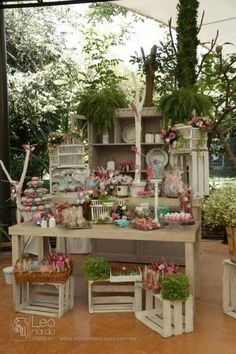 Love the combination of the wooden crates, greenery and colour in this display