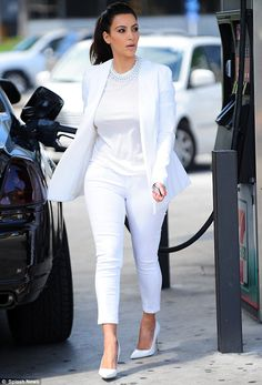 LOVE the ALL WHITE!!!!  Fuelling up: Kim later stopped at a 7-Eleven to pump gas into her Roll Royce Phantom