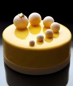 A mirror glazed cake with white chocolate sprayed truffles. By Dinara Kasko