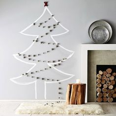 When I was flat broke and lived in an apartment with zero room for a tree, I tacked a string of lights to the wall in this shape and tacked ornaments to the space in the middle. It worked. I have to have some sort of tree every year.