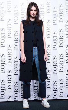 sleevelss-jacket-long-vest-patchwork-denim-cropped-jeans-via-getty