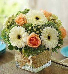 """Modern Rose and Gerbera Daisy Bouquet """"This design stirs up feelings of peace and tranquility."""" The arrangement features roses, gerbera daisies, hypericum and a garden variety of greenery in a cube va #moderngardendesign"""
