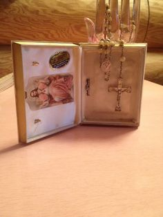 Rosary.  Sterling.  Came with its own bible plastic case. From around 1960.