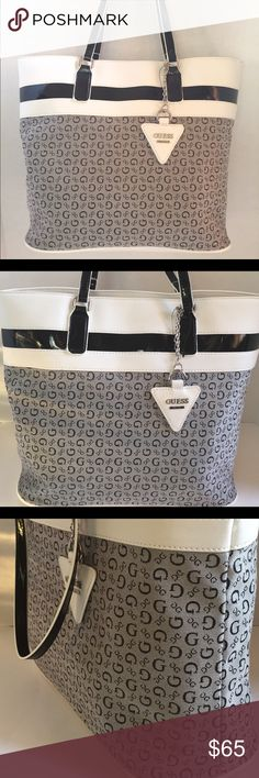"""SALE GUESS BUENOS DIAS TOTE HANDBAG LARGE GUESS BUENOS DIAS TOTE HANDBAG  STYLE: BB493925  COLOR: BLACK/WHITE    ~NEW WITH TAG~    This listing is for a GUESS BEAUTIFUL TOTE style Handbag.    Top magnetic button  closure Guess logo on front with Silver tone hardware Interior one full slide pocket & 3 slip pockets.  Faux leather top white and black and the bottom   Measurements: 14""""x11""""x5""""  Straps 8.5"""" Drop  I accept REASONABLE offers only!           NO TRADES! Guess Bags Totes"""