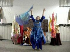 Jeanetter Strauss of Glorious Creations. Worship and Praise dance with flags on spin tubes.