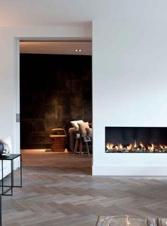 open fireplace with black & white interior