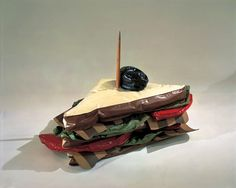 Claes Oldenburg, Giant BLT (Bacon, Lettuce, and Tomato Sandwich), 1963. Vinyl, kapok fibers, painted wood, and wood, 32 × 39 × 29 in. (81.3 × 99.1 × 73.7cm). Whitney Museum of American Art, New York; gift of The American Contemporary Art Foundation Inc., Leonard A. Lauder, President  2002.255a-s