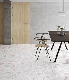 In keeping with the ongoing trend for marbling effects within interior surfaces, our new Inker porcelain tile offers instant impact in kitchens, bathrooms, hallways, conservatories and garden rooms, and can be applied to both walls and floors. Soft and swirling, the eye-catching marbling look is available in Blue, Clay, Green, Grey, Pink and Silver. It can be used to contrast or complement any project, with coloured accents that can be picked up elsewhere within the space. Porcelain Ceramics, Porcelain Tile, Pink Tiles, Splashback, Conservatory, Marble, Artisan, Flooring, Interior
