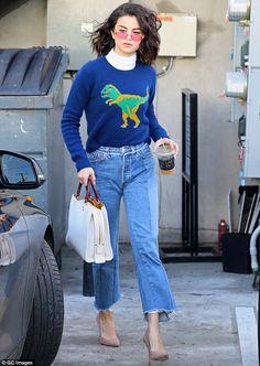 Do-ya-think-she-saurus? Selena seemed blissfully unaware as she headed back to her car...