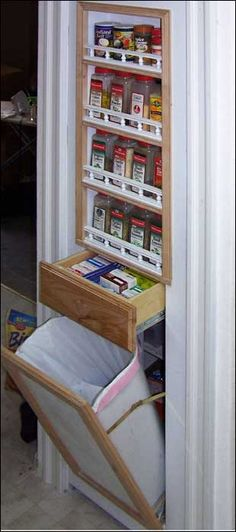 A Pantry is Concealed by a Kitchen Cabinet Doorway http://www.hiddenpassages.com/images/gallery/28.jpg Hidden Kitchen, Open Kitchen, Kitchen Spice Storage, Door Storage, Cottage Kitchens, Home And Living, Hidden Passages, Pantry Doors, Home Remodeling