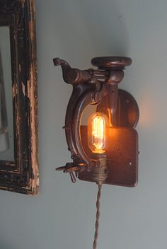 I want these! Vintage industrial sewing machines made into wall sconces.  Etsy.