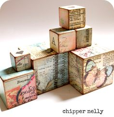 I love the blocks @... Fee Bryce-clegg has made for me using print and vintage maps.  http://www.lifeonplanetbaby.com/