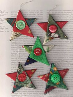 Star Christmas ornaments, fabric star, country cottage Christmas, Christmas decor, Christmas star, red green gold silver stars, tree decorations  A set of five (the five pictured) Christmas tree ornaments in the shape of trees, created from a variety of folded Christmas fabrics in red, blue, green, white, silver and gold. They have a silver hanging loop, and a red or green vintage button tied in the centre. Each star measures approximately 7.5cm (3in) tall/wide and the hanging loop is…