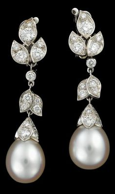 18 karat white gold and diamond earrings, Cartier satine collection Consisting of delicate articulated floral links accented by petite round brilliant cut diamonds, finishing in a single white egg drop pearl. Accompanied by original box, signed by the maker serial no. 956876.