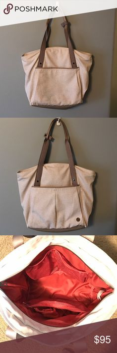 Live Free Tote Beige Live Free Tote. Never used, tags attached. Perfect for the gym, beach, or daily use! lululemon athletica Bags Shoulder Bags