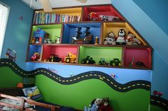 bed and shelving in transportation room with train, tractor, truck, etc decals with road that runs around the room (parts of it are magnetic) Car Themed Bedrooms, Big Boy Bedrooms, Bedroom Themes, Bedroom Ideas, Kids Bedroom Designs, Kids Room Design, Monster Truck Bedroom, Truck Room, Car Room