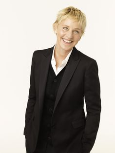 Ellen Degeneres! I love her and everything she stands for:) and I would really love to have her wardrobe!! Haha