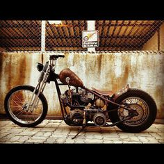 Hardtail shovelhead springer custom  with rusted tins and skull tank shifter