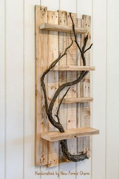 Handmade Wall Art Shelf A charming and beautifully handmade rustic floating wall shelf which would make an attractive addition to any room in the house. We feel the distressed wood, nail holes and knots enhances its rustic character. A gorgeous branch one of the great features of #handmadehomedecor