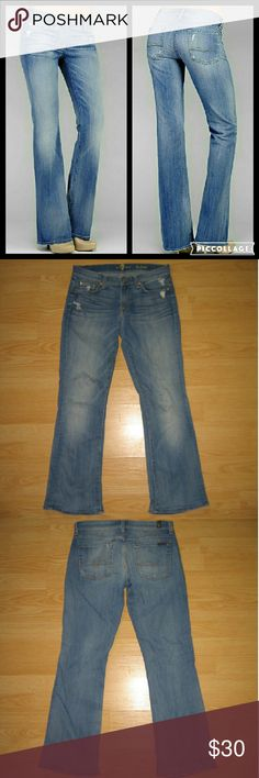"7 For All Mankind Distressed Bootcut Jeans These jeans are preloved but still in very good condition. They are the Bootcut jean in Distressed Del Azul wash. Style# is AU075Y17A. The distressing is factory intended but some may have more wear than originally intended. Made of 98% cotton 2% spandex. Tag size is 27.  Waist across with natural dip is 14.75"" Waist across when aligned is 15.25"" Front Rise is 7.75"" Inseam is 28"" (these jeans are hemmed with the original hem) 7 For All Mankind Jeans…"