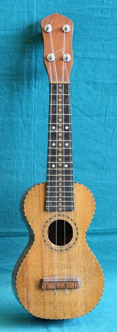 early 20s Harmony Soprano with all the binding  --- https://www.pinterest.com/lardyfatboy/