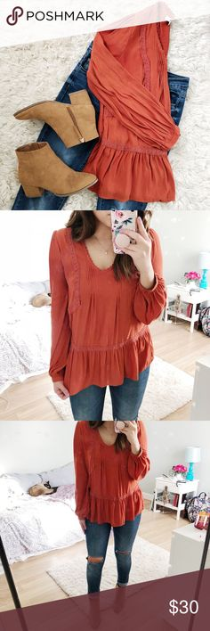 Flowy Blouse This is a very pretty burnt orange color. Light weight material perfect for any season. Cuff sleeves and flare waist detail. RO&DE Tops Blouses