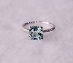 i have decided that i LOVE the engagement rings made with aquamarine! still classic but just a little it different