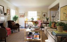 Eclectic living room with layers of pattern, color & art - home of designer Annie Anderson