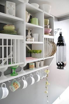 I like having lots of exposed shelving and open cabinets for display of collecibles and nice dishware