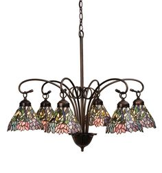 30 Inch W Wisteria 6 Lt Chandelier - 30 Inch W Wisteria 6 Lt ChandelierStylized wisteria flower clusters of China Pink,Grape and Amethyst Blue with Jade Green leaves drapeover this Ivory toned graceful copper foil pendantshades. The classic styling of this Tiffany inspiredstained glass six light chandelier and soft pastelcolors will add charm to any room. Theme: VICTORIAN TIFFANY FLORAL Product Family: Wisteria Product Type: CEILING FIXTURE Product Application: CHANDELIER Color: BEIGE PINK…