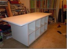 Wicked sewing table made of Ikea pieces. Two Kallax shelving units back-to-back with a table top (you can order table tops separate from legs or choose legs to go with any table top). Ikea Sewing Rooms, Sewing Room Storage, Sewing Room Organization, My Sewing Room, Sewing Desk, Sewing Tables, Studio Organization, Woodworking Joints, Woodworking Workbench