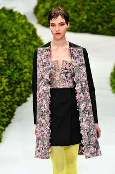 Christian Dior embroidery in Haute Couture Atelier   sewing black coat  flowers  applique