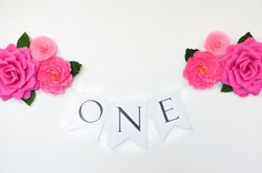 This listing is for a birthday banner ONE, decorated with handmade paper flowers. Perfect for first birthday parties.  Flag measures: Letters O and E - approx. 5.5 wide by 7.5 high Letter N - approx. 6 wide by 8.3 high Made from white cardstock.  Flower measures: 2 large roses - approx. 9 2 medium peonies - approx. 6 2 small roses - approx. 4 colors: 3 pink shades ( #949, #954 and #950 - see the attached color chart)  Custom orders are always welcome! Please convo me if you want to buy…