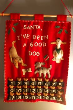 This was my mother's early Christmas present for her grandpuppy, Darwin. She purchased the calendar, but the dog biscuits are HOMEMADE!!!  Darwin received his first biscuit last evening when I got home from work. When I left this morning, he was sitting beneath it, nose turned up, whining for another!  It is hard to explain the concept of 'advent' to a creature whose brain is located in his belly.